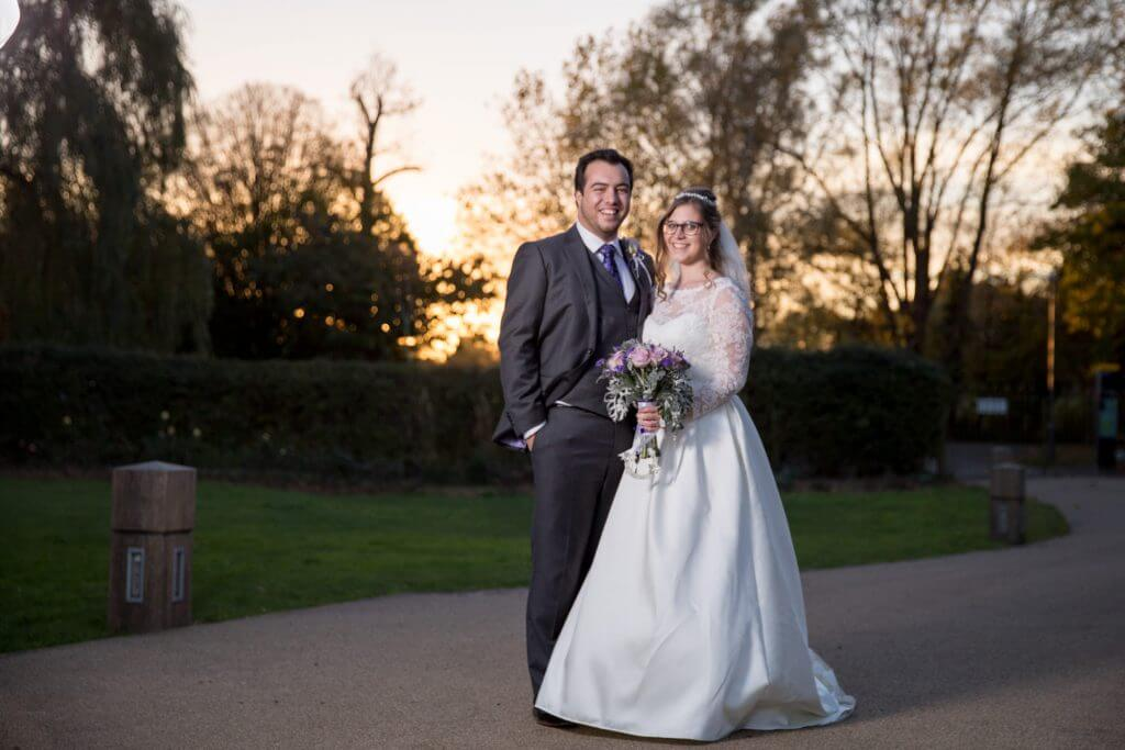 37 bride groom with gorgeous sunset backdrop headstone manor harrow middlesex oxfordshire wedding photography