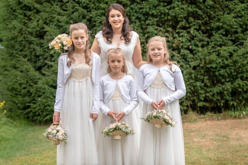 38 bride young bridesmaid with flowers traditional family group portait oxford venue oxfordshire wedding photography