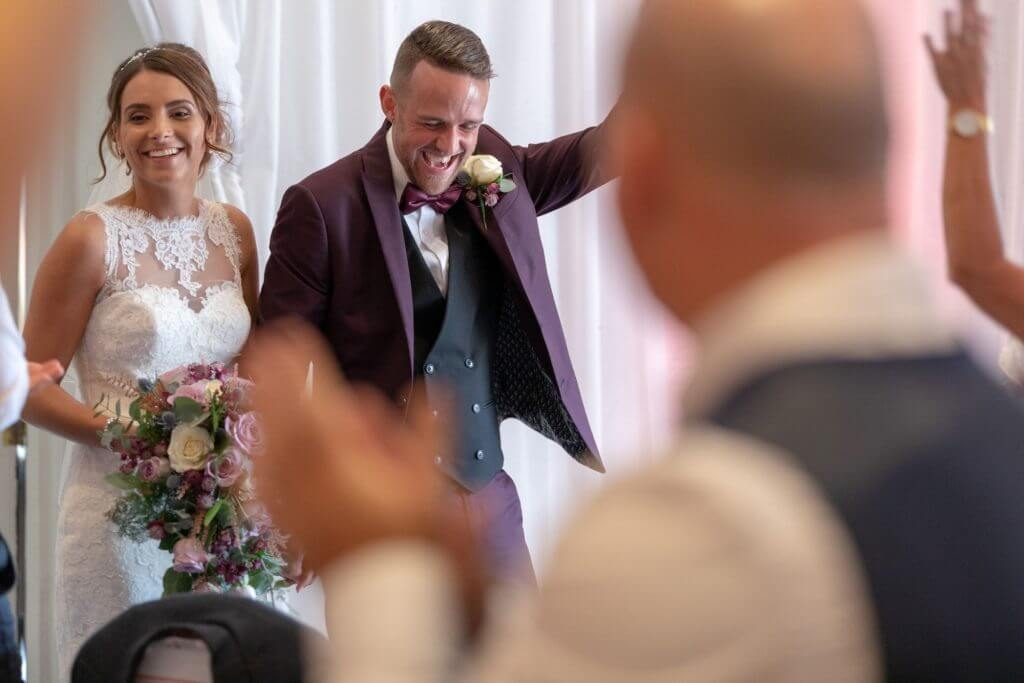 38 happy groom and bride with bouquet milton hill house reception oxfordshire wedding photography