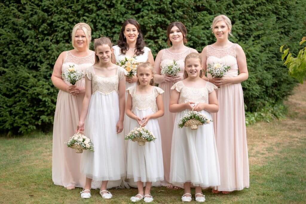 39 bride bridesmaids in pink and white with flowers summer garden venue oxford wedding photography