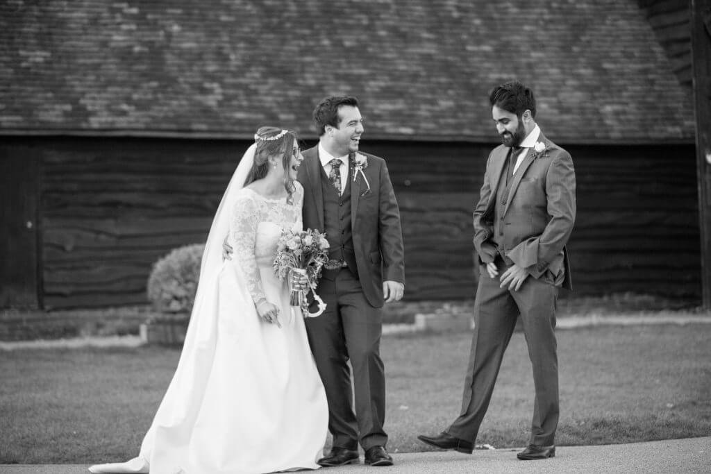 39 bride groom joke with best man the great barn headstone manor harrow middlesex oxfordshire wedding photographer