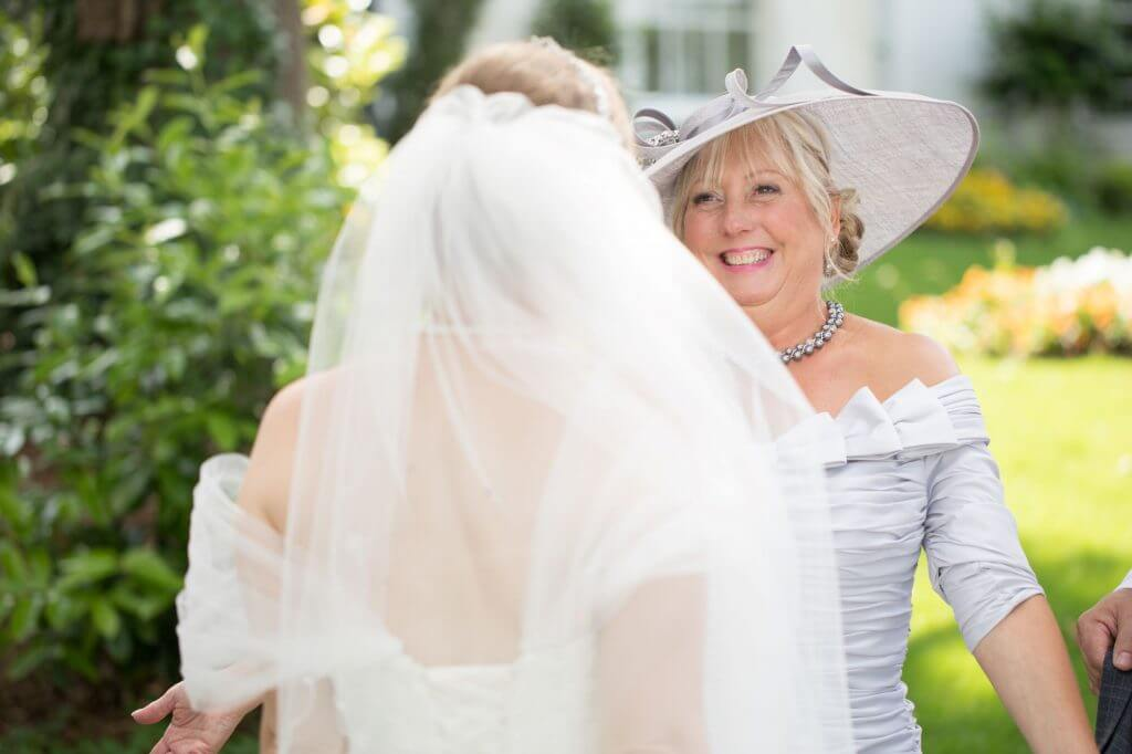 39 bride just married greets smiling mother de vere beaumont estate venue windsor berkshire oxfordshire wedding photography
