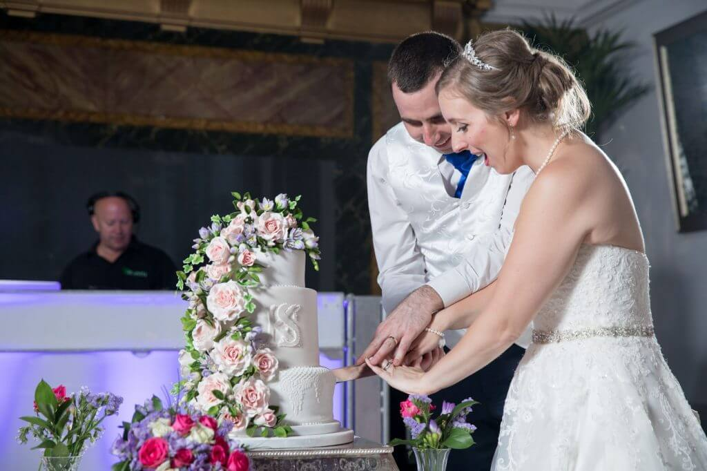 42 bride groom cake cutting ceremony de vere beaumont estate venue windsor berkshire oxfordshire wedding photography