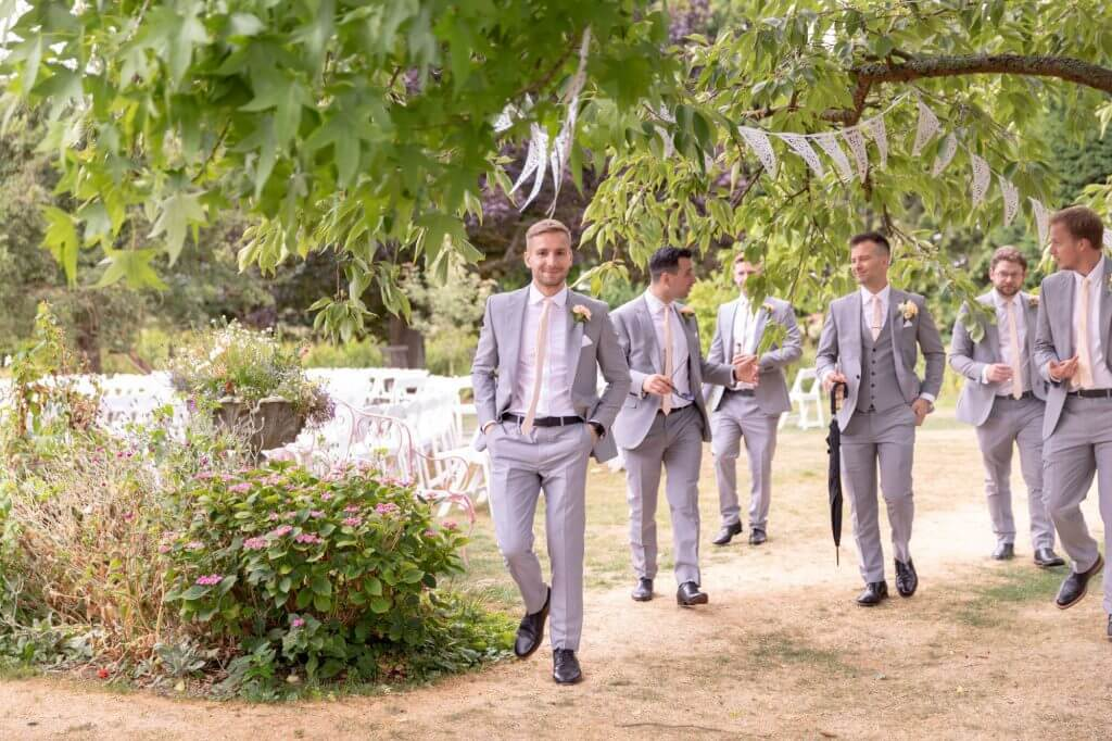 42 groom bestman groomsmen summer garden champagne reception oxford venue oxfordshire wedding photography