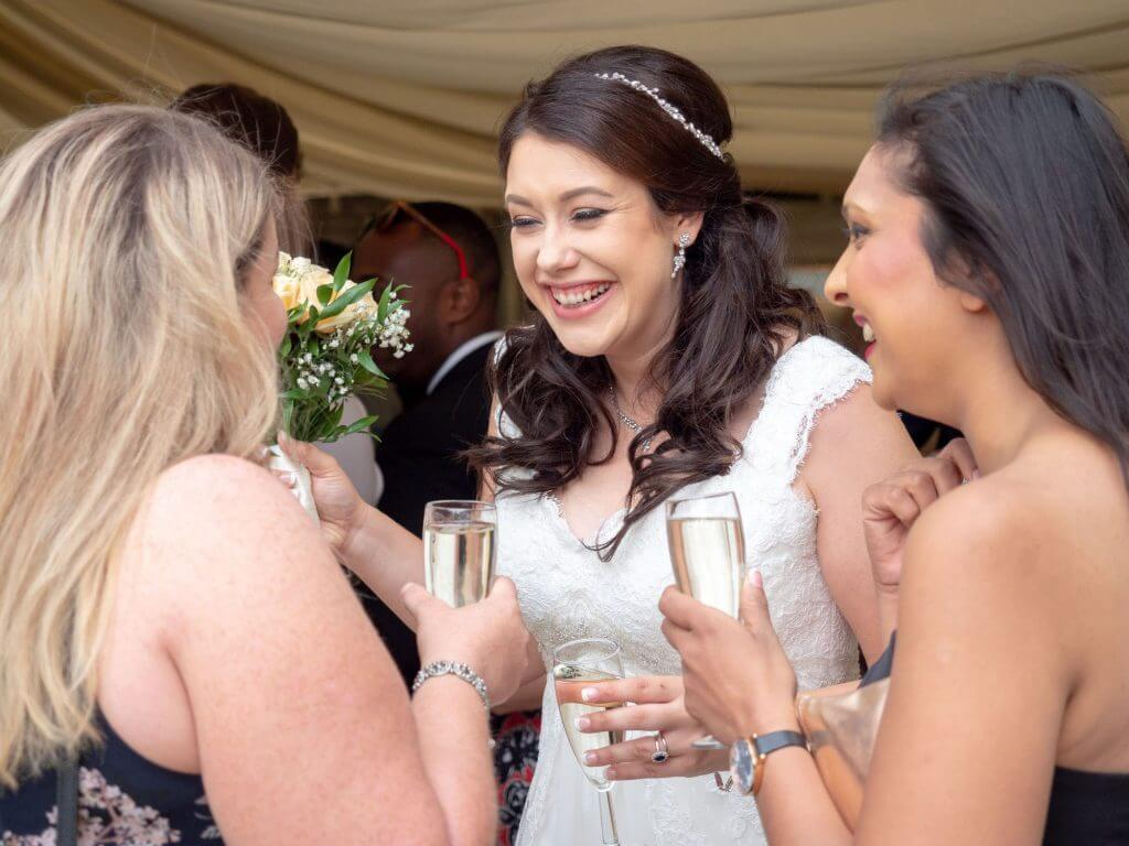 44 bride brides friends riverside champagne reception cherwell boathouse venue oxford wedding photography