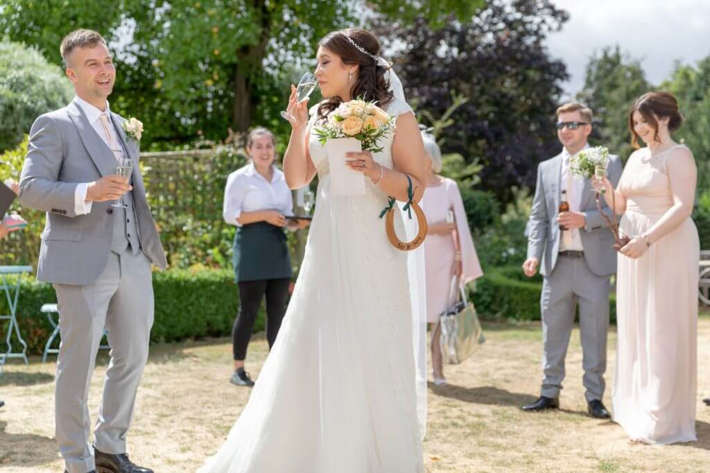 45 bride groom groomsman bridesmaid champagne reception summer garden venue oxford wedding photography