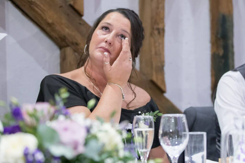 47 tearful mother of the groom top table reception dinner the great barn headstone manor harrow middlesex oxfordshire wedding photographer