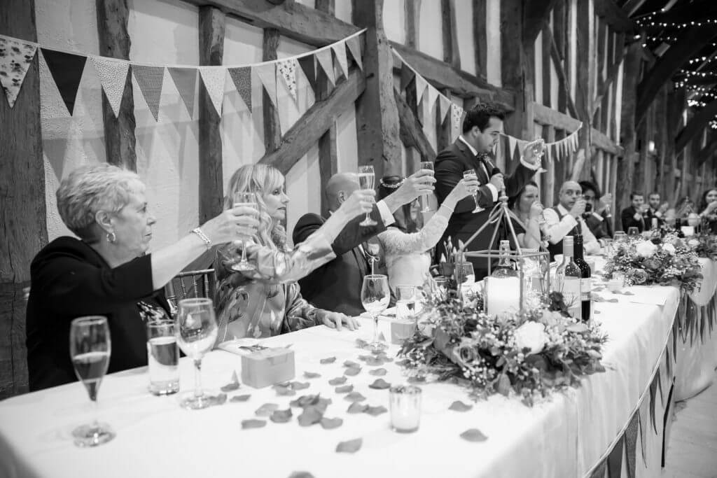 48 grooms toast at top table reception dinner the great barn headstone manor harrow middlesex oxfordshire wedding photography