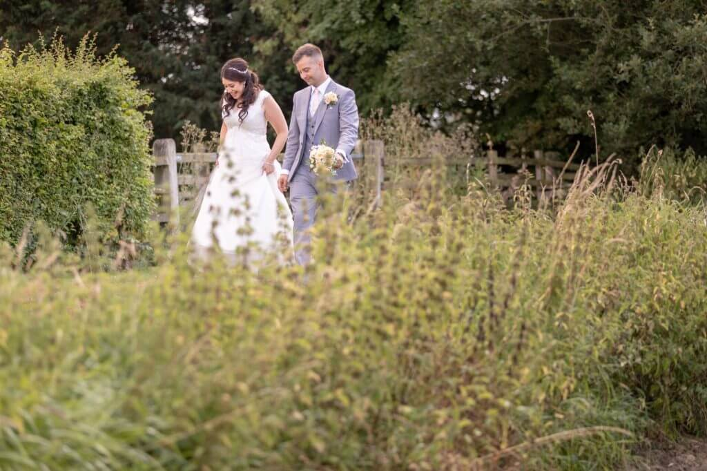 51 bride groom with bridal bouque summer garden reception oxford oxfordshire wedding photography