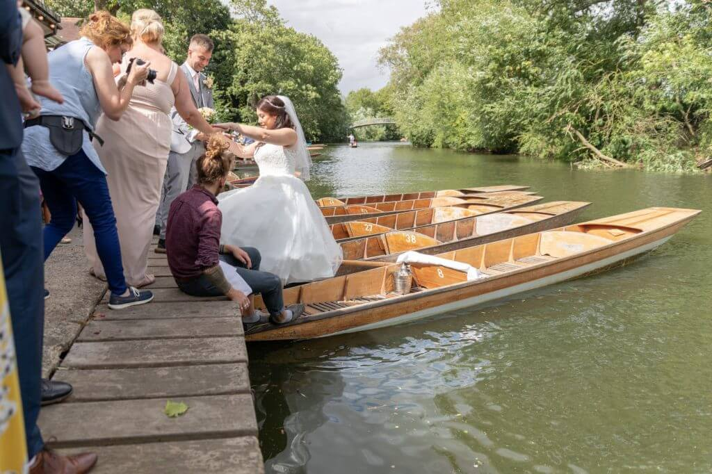 64 just married couple champagne boating trip river cherwell by punt cherwell boathouse riverside reception venue oxford wedding photography