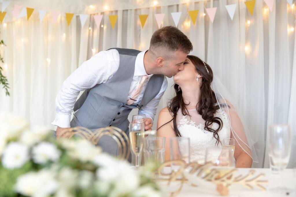 70 bride groom kiss champagne riverside reception cherwell boathouse venue oxford oxfordshire wedding photography