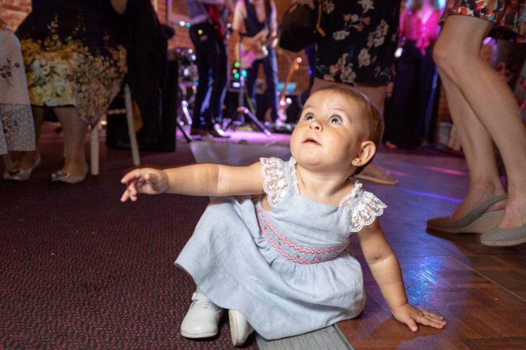 79 baby guest listens to wedding band and watches dancing evening party celebration oxford wedding photography