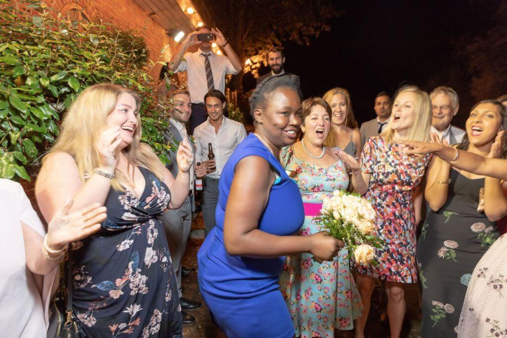 82 party guest catches brides bouquet riverside champagne reception cherwell boathouse venue oxford wedding photography