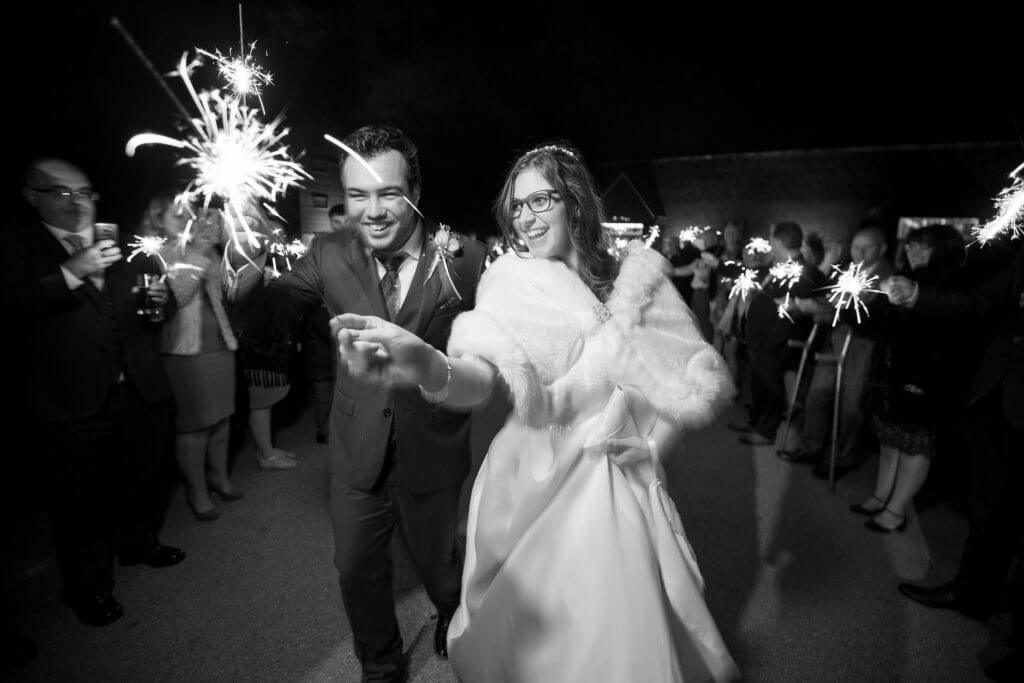 bride and groom sparklers celebration party the great barn headstone manor harrow middlesex oxfordshire wedding photographer
