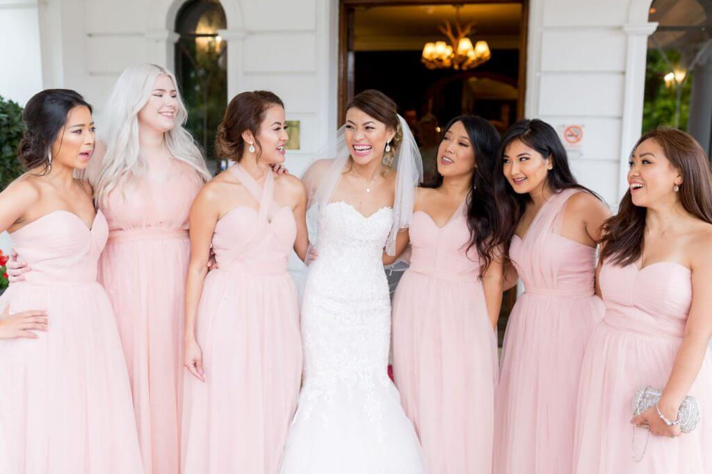 asian bride in white dress with bridesmaids pink dresses champagne reception milton hill house steventon abingdon oxford oxfordshire wedding photography 19