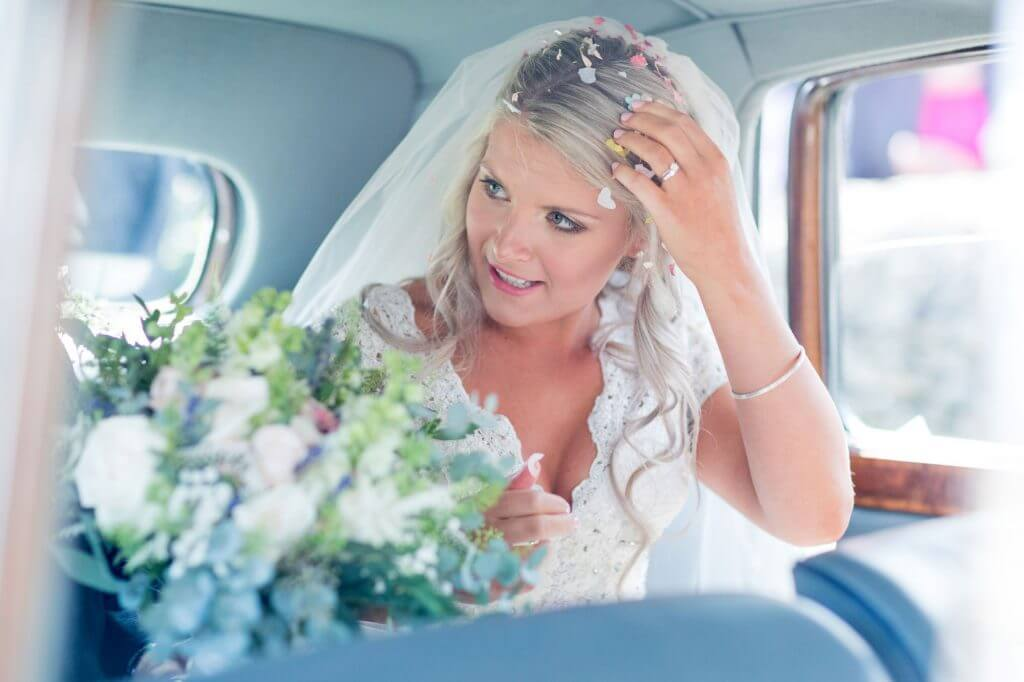 bride flowers bouquet bridal car confetti after church marriage ceremony oxfordshire wedding photography 61