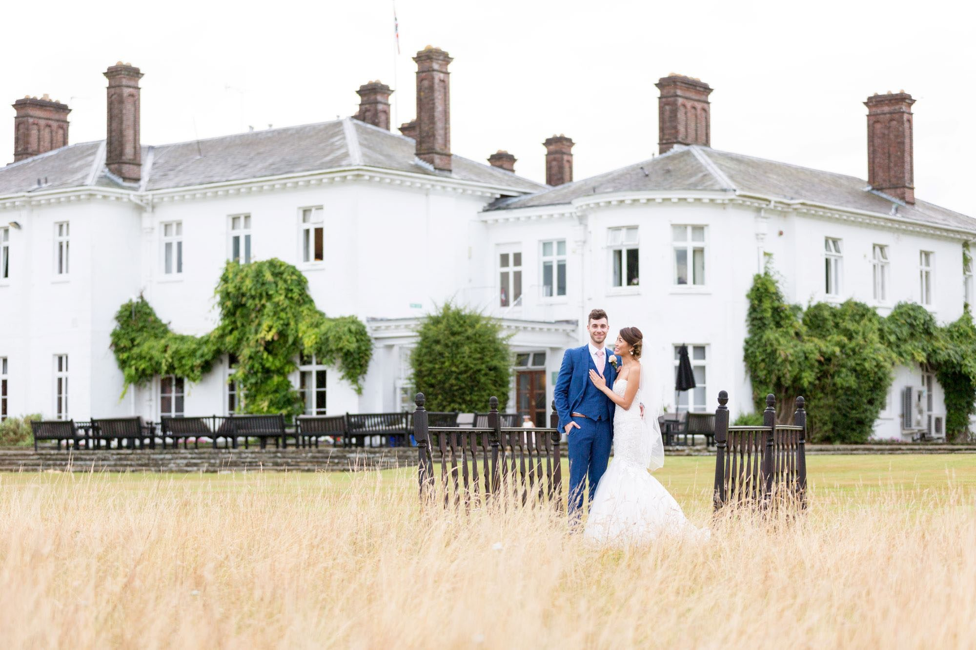 bride groom in front of milton hill house venue steventon abingdon oxford oxfordshire wedding photographer 35