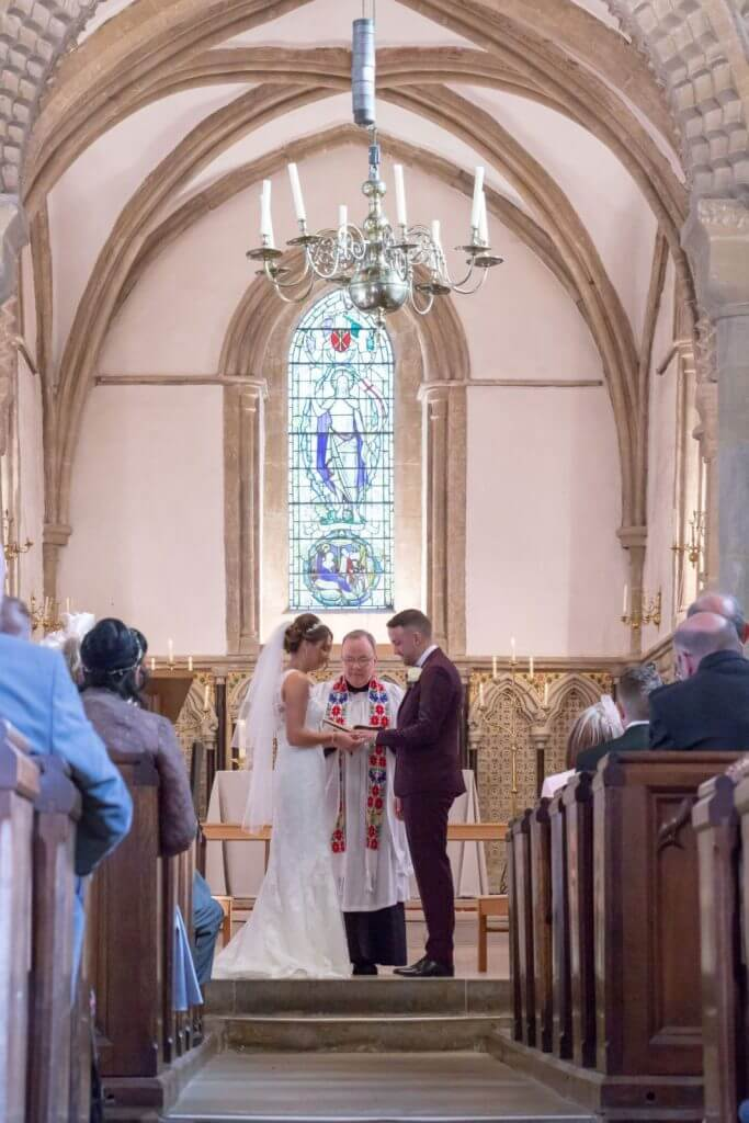 bride groom marriage ceremony exchanging rings iffley village church oxford oxfordshire wedding photography 34