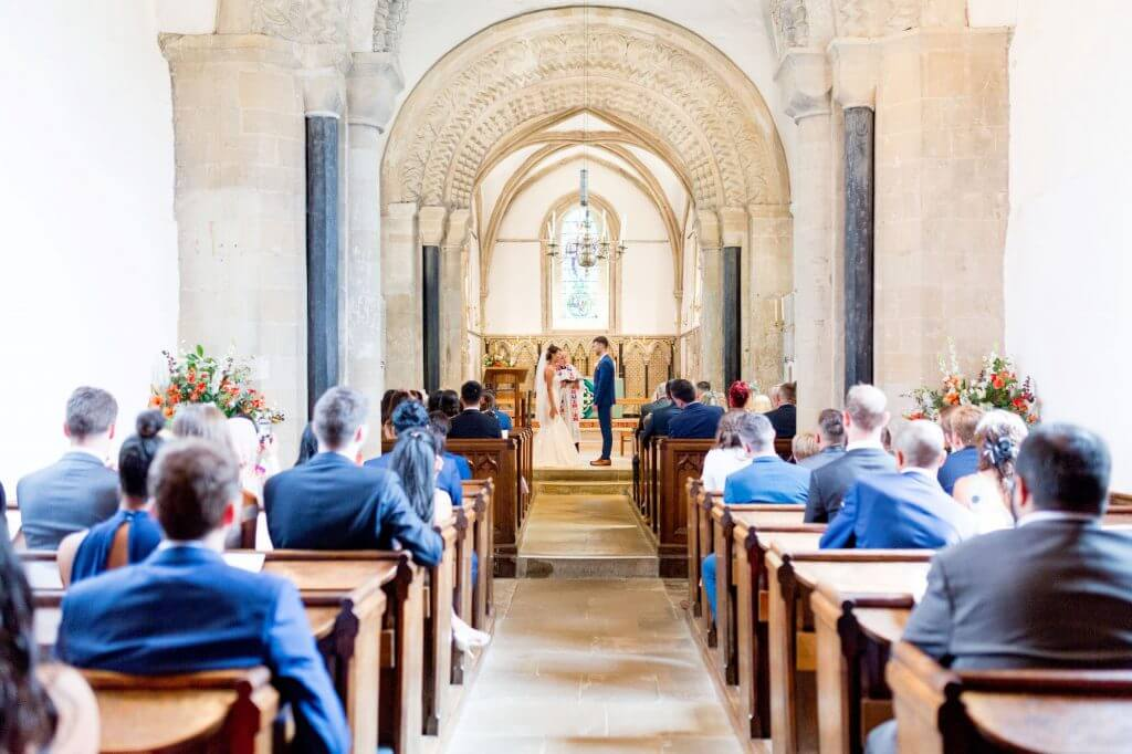 bride groom married by vicar at alter iffley village church oxford oxfordshire wedding photographer 08