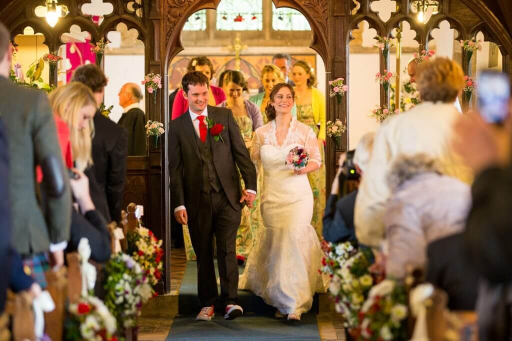 bride groom walk down church aisle oxfordshire village oxford wedding photography 42