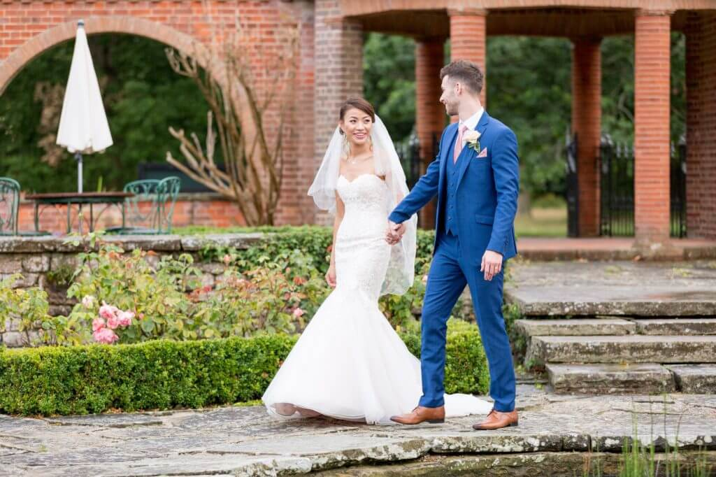 bride white dress groom blue suite roses buttonhole milton hill house gardens venue steventon abingdon oxford oxfordshire wedding photographer 36