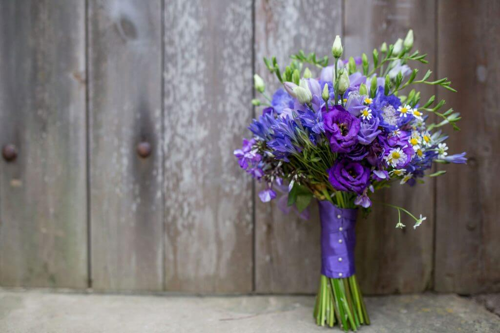 brides blue bouquet of flowers barn venue marriage ceremony oxfordshire wedding photography 46