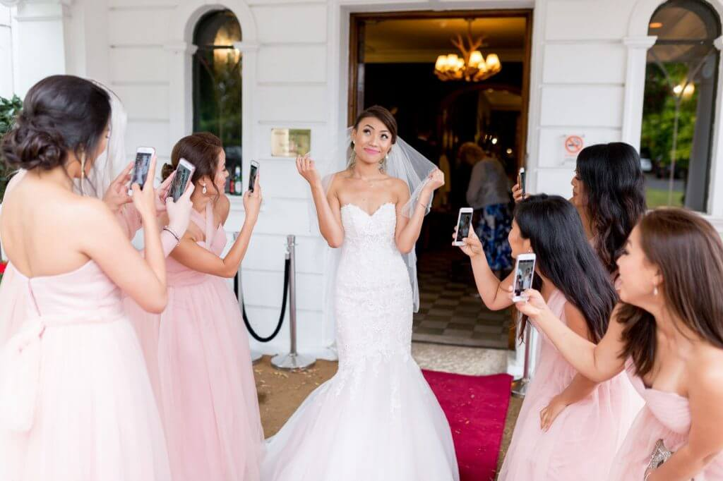 bridesmaids in pink dresses photograph brides white dress champagne reception milton hill house steventon abingdon oxford oxfordshire wedding photographer 21