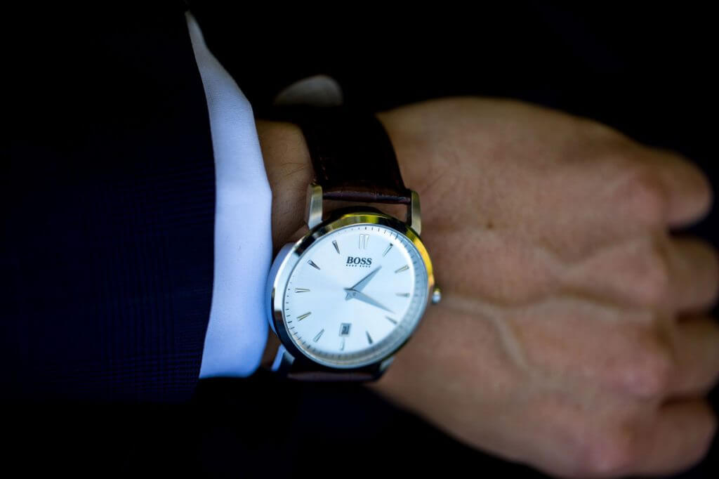 groom preparation showing boss dress watch before marriage ceremony oxfordshire wedding photography 52