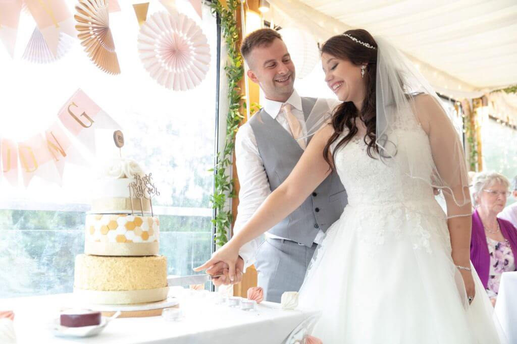 tiered cake cutting reception bride groom cherwell boathouse riverside venue oxford oxfordshire wedding photography 06