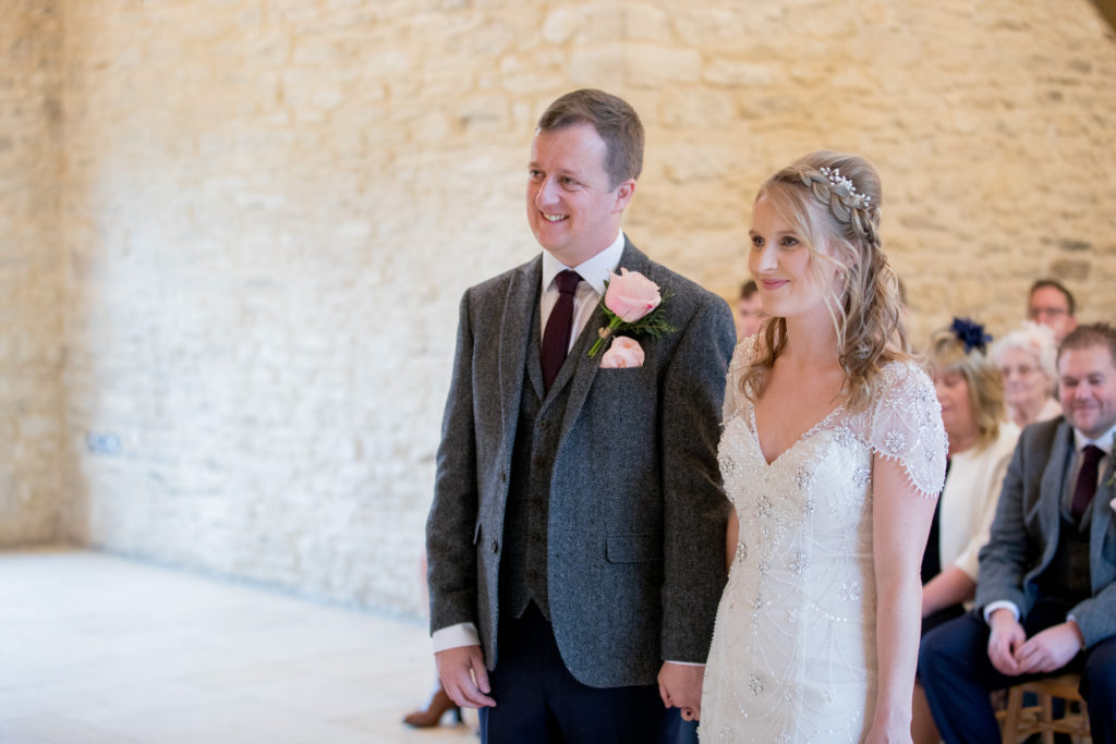 smiling bride groom getting married kingscote barn tetbury oxford wedding photography