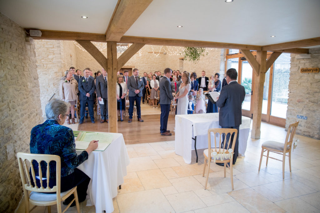 celebrant marrying bride groom kingscote barn tetbury oxford wedding photography
