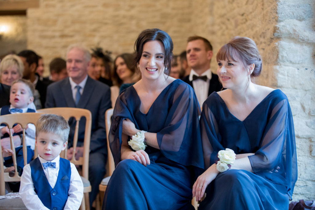 bridesmaids and page boy watch ceremony kingscote barn tetbury oxford wedding photographer