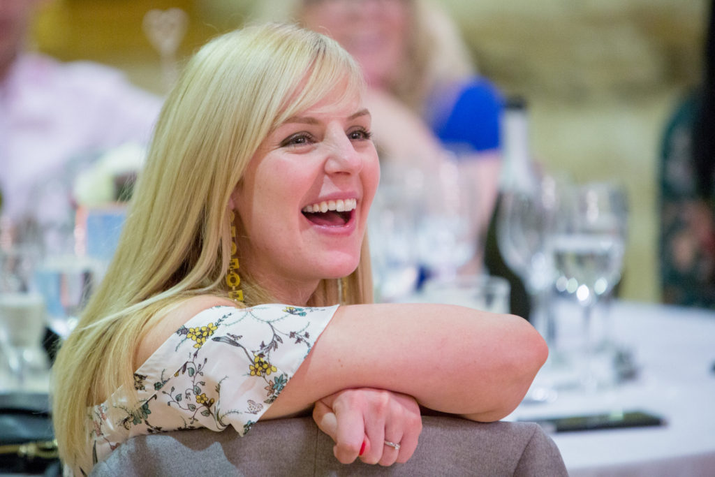 laughing lady guest dinner reception kingscote barn tetbury oxford wedding photographer