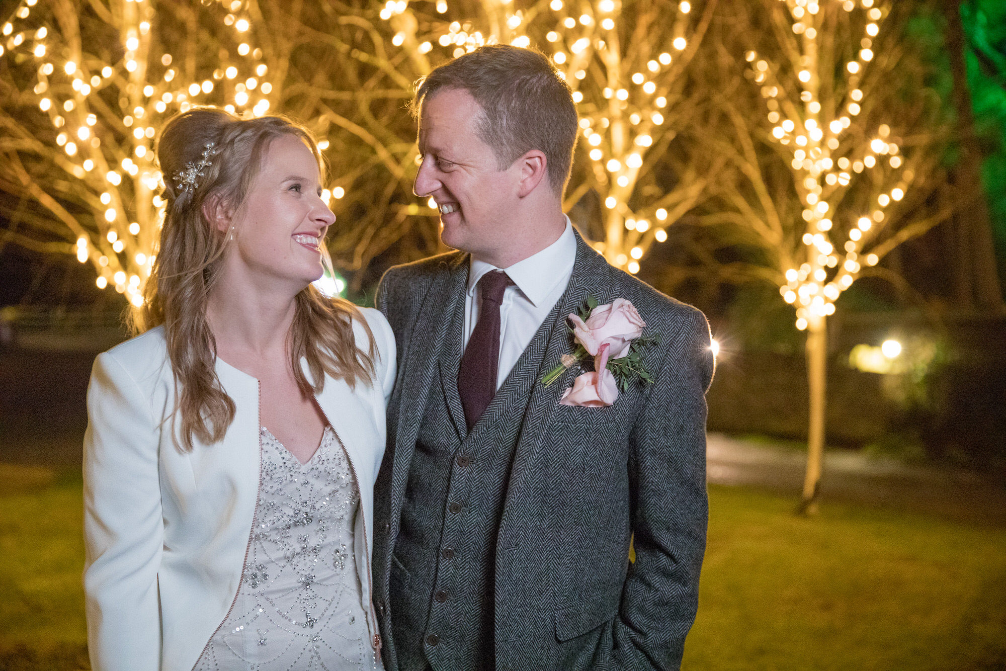 bride groom with Christmas fairy tree lights kingscote barn tetbury oxford wedding photographer