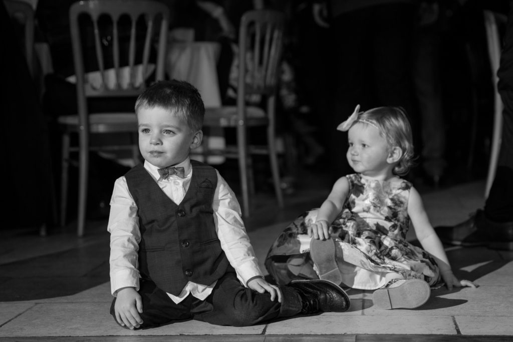 pageboy and toddler sit on dance floor kingscote barn tetbury oxford wedding photography