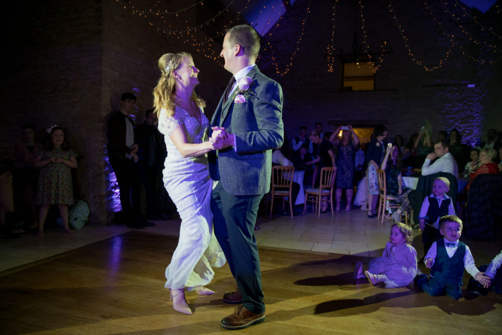 bride groom first dance watched by children kingscote barn oxford wedding photographer