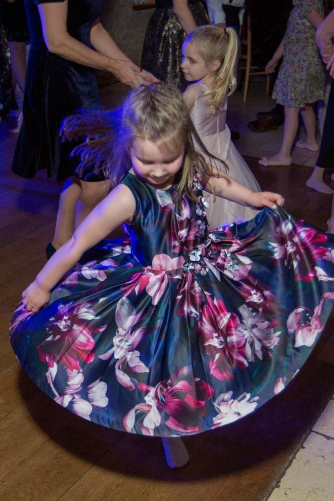 young girl dances at reception party kingscote barn tetbury oxfordshire wedding photographer