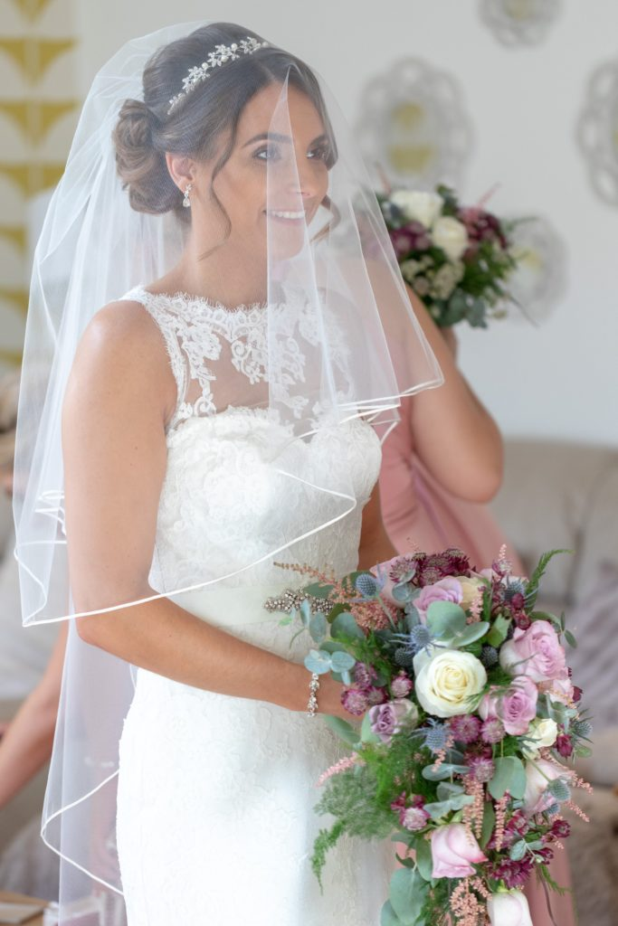 veiled bride with floral bouquet milton hill house abingdon oxfordshire wedding photography