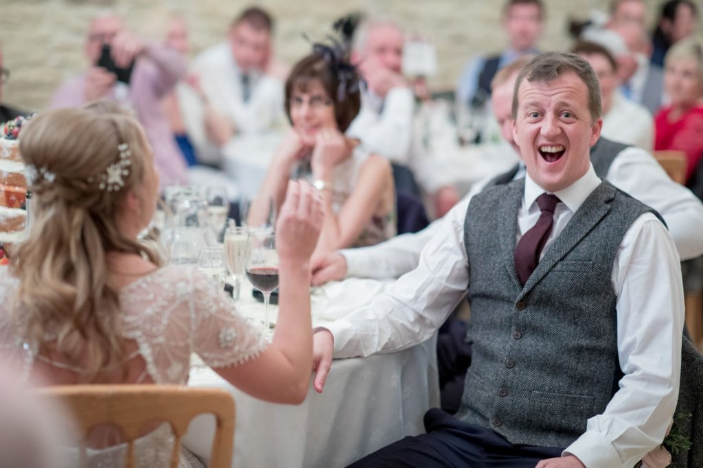 laughing groom kingscote barn tetbury reception oxford wedding photography