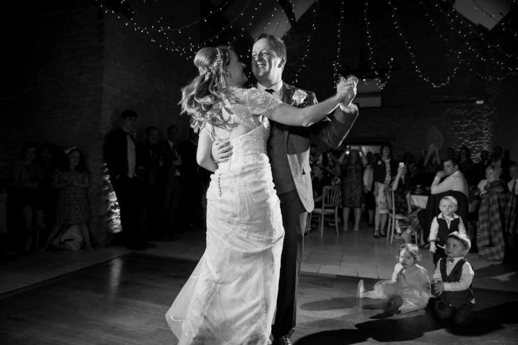 bride groom first dance kingscote barn tetbury oxfordshire wedding photography