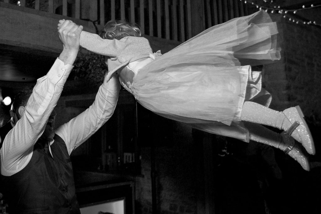 dad swings daughter high kingscote barn reception party oxford wedding photographers