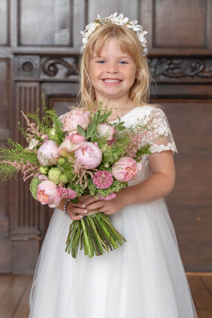 smiling bridesmaid floral bouquet stately home venue oxford wedding photography