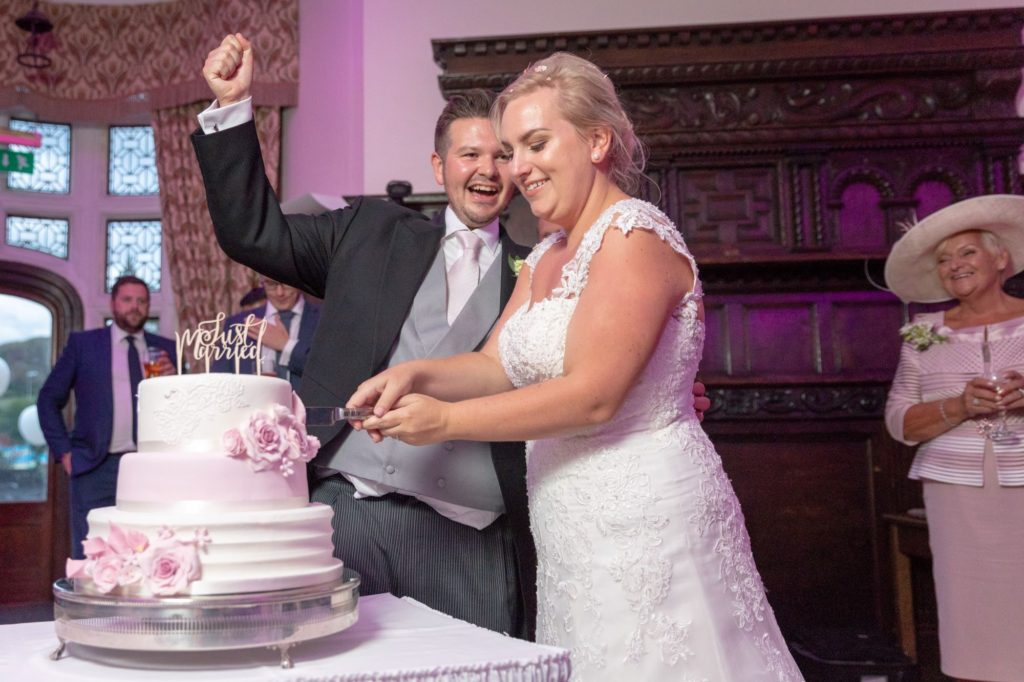 bride groom cut cake stately home venue oxfordshire wedding photography