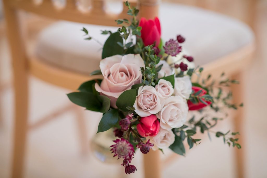 floral arrangement marriage ceremony kingscote barn venue tetbury oxford wedding photographers
