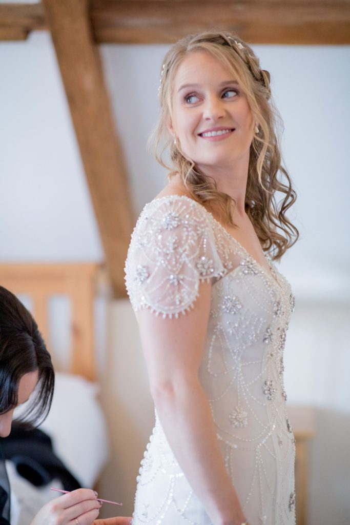 bride dress preparation kingscote barn venue tetbury oxfordshire wedding photographer