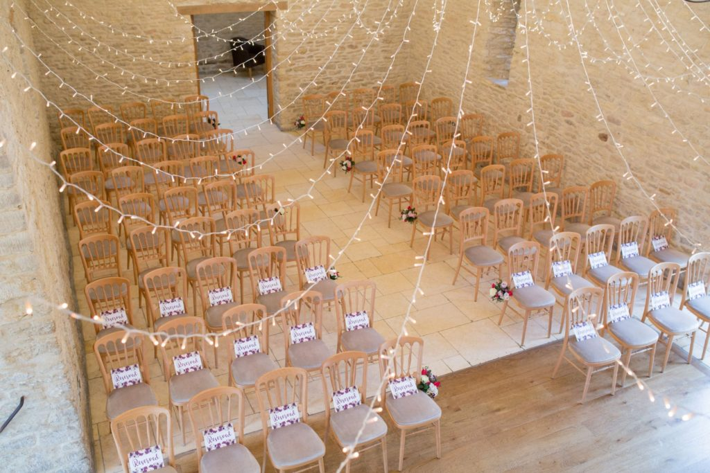 marriage ceremony fairy lights kingscote barn venue tetbury oxfordshire wedding photographers
