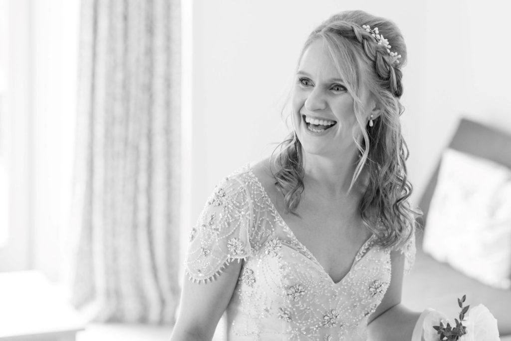 smiling bride bridal prep kingscote barn tetbury oxford wedding photographer
