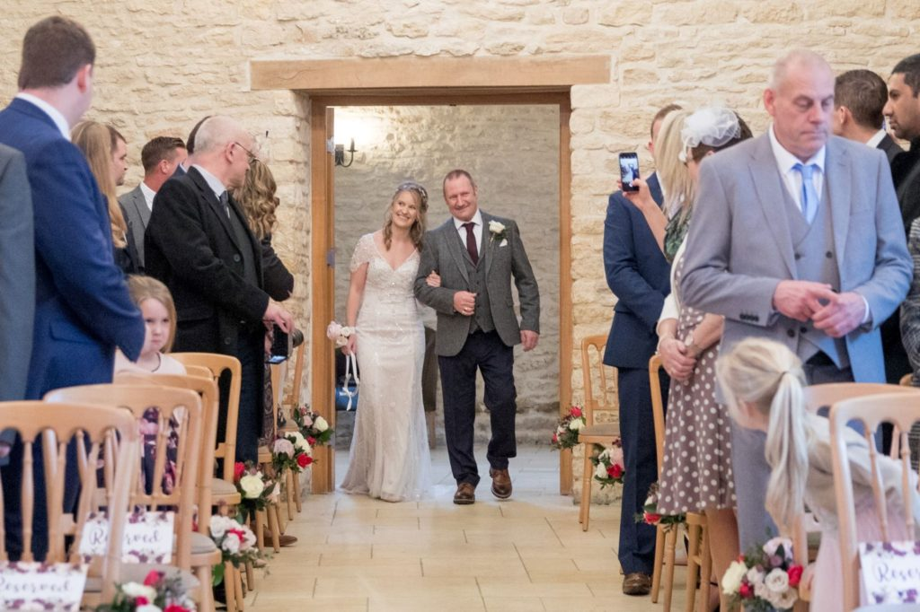 father walks bride down aisle kingscote barn marriage ceremony tetbury oxfordshire wedding photographers
