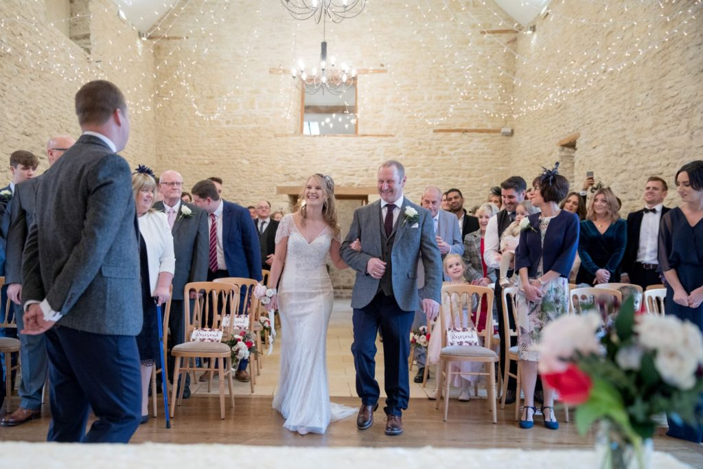 bride and father join groom at alter kingscote barn marriage ceremony oxford wedding photography