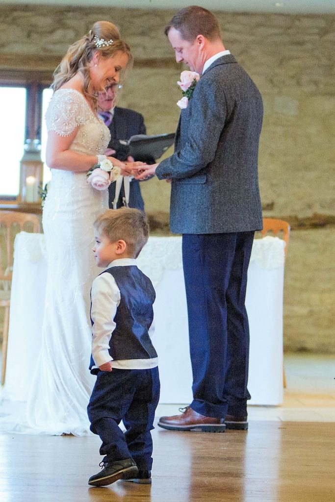 pageboy bride groom marriage ceremony kingscote barn tetbury oxford wedding photographer